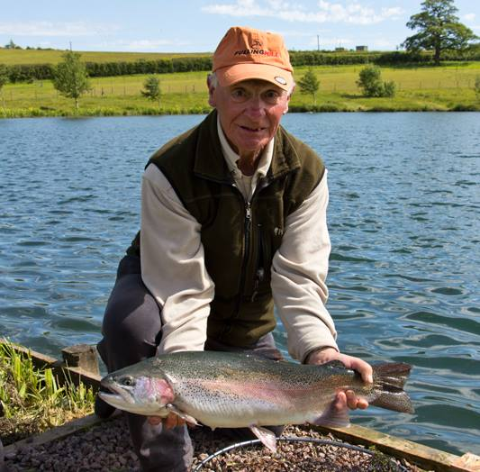 Ken Bowring with a Cwm Hedd rainbow weighing 8lb 4oz
