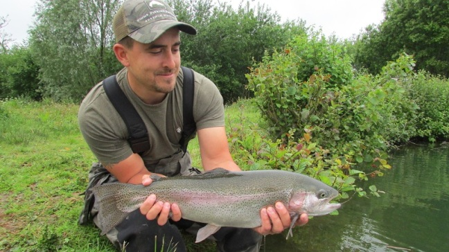 Luke Thomas with his pristine Cwm Hedd rainbow weighing 6lbs 5oz