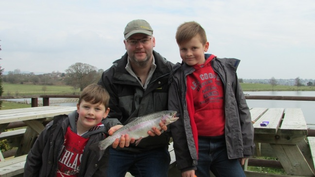 Mark Whalley (centre) with  six year old Oliver and ten year old Devon